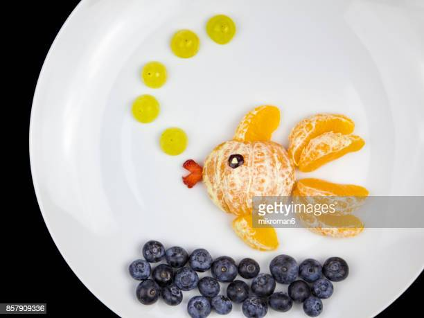 Fruits fish, goldfish.  Fruit Art Recipe. Food art creative concepts.