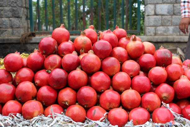 fruits for sale at market stall - pomegranate tree stock photos and pictures