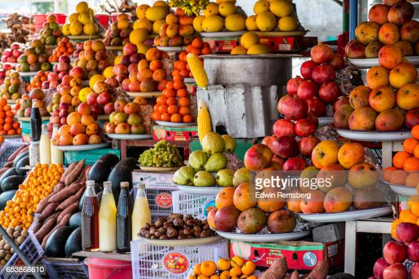 fruits for sale - tropical fruit stock pictures, royalty-free photos & images