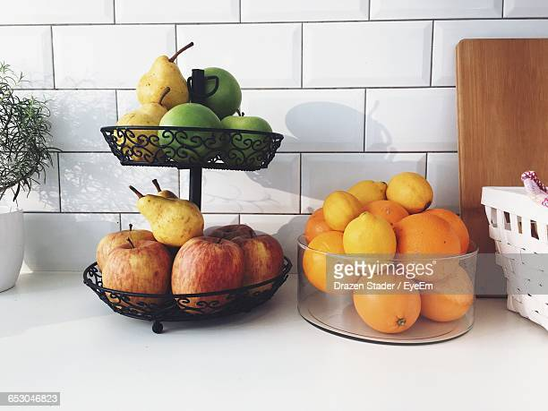 Fruits In Containers On Table In Kitchen
