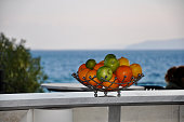 fruits bowl table with ocean background