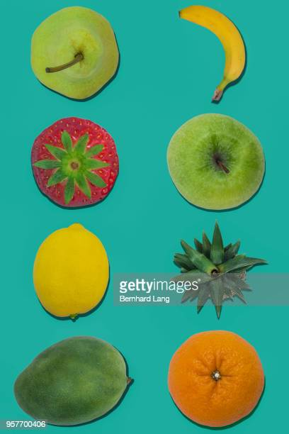 Fruits on green background, top-down view