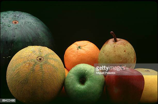 orange apples watermelon pear and melon