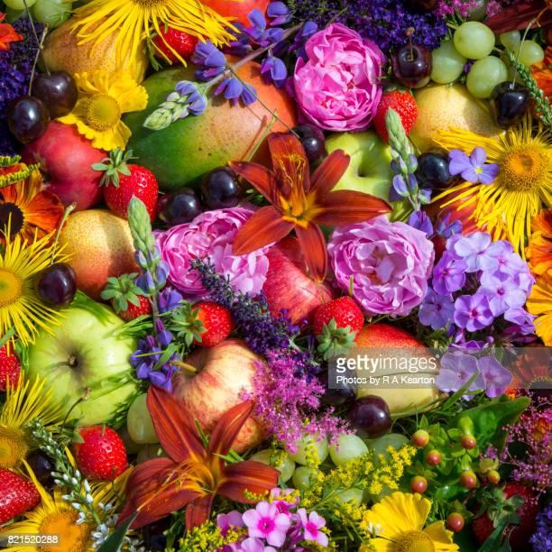 Fruity, floral arrangement of summery produce