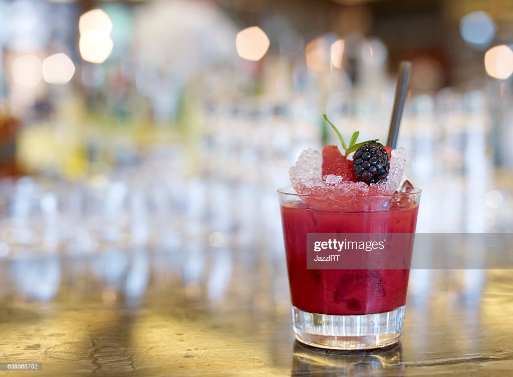 Fruity strawberry surrounded by fresh strawberries : Stock Photo