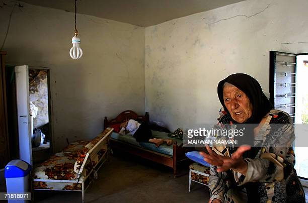 TO GO WITH AFP STORY BY JOCELYNE ZABILT Fatima Moukdad expresses her anger 05 September 2006 as she stands next to a sick elderly member of the...