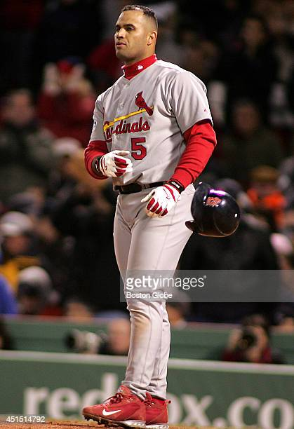 A frustrated Albert Pujols tosses his helmet after striking out swinging to end the 6th inning