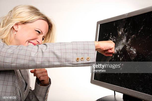 Frustrated Angry Businesswoman Punches Monitor after Computer Crash