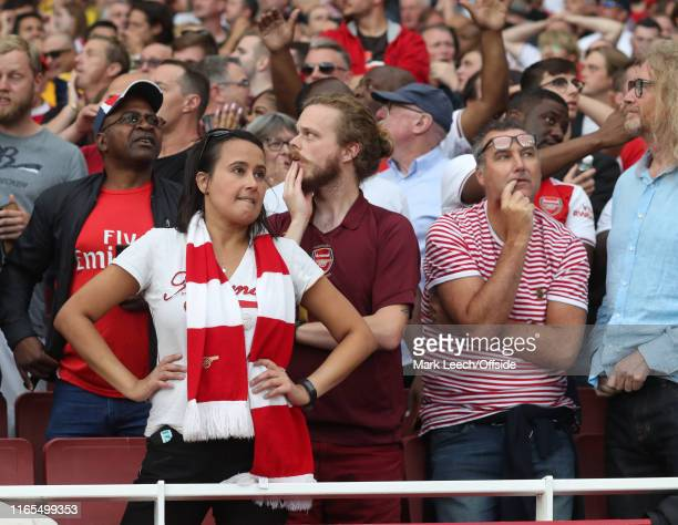 frustrated Arsenal supporters await the VAR decision on a potential winning goal during the Premier League match between Arsenal FC and Tottenham...