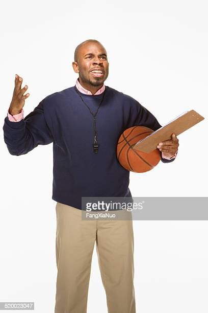 Frustrated basketball coach, on white background
