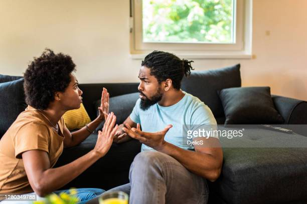 frustrated black couple arguing. - arguing stock pictures, royalty-free photos & images
