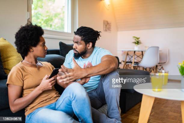 frustrated black couple arguing. - boyfriend stock pictures, royalty-free photos & images