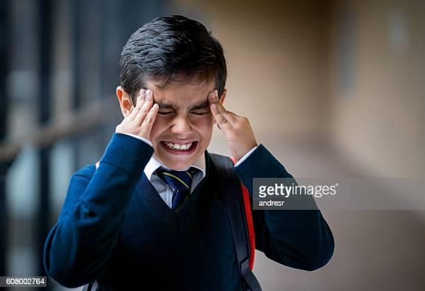 frustrated boy at school - bullying escolar fotografías e imágenes de stock