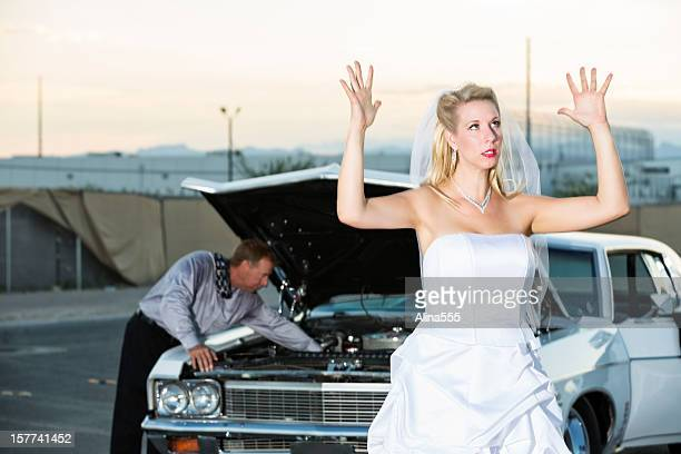 Frustrated bride waiting for her groom to fix the car