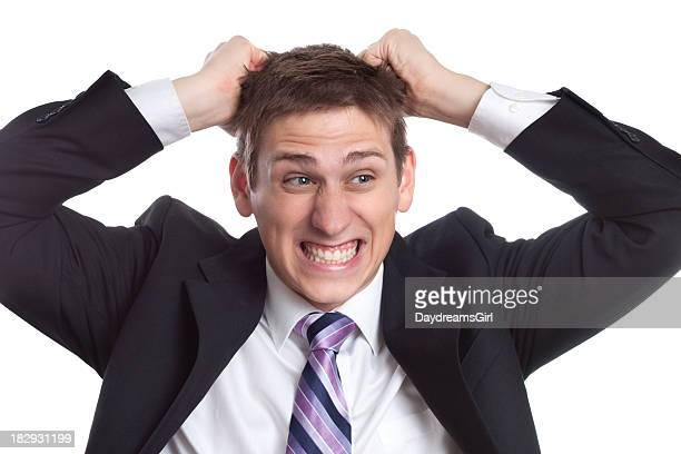 Frustrated Business Man Pulling Hair Out