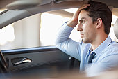 Frustrated businessman driving car