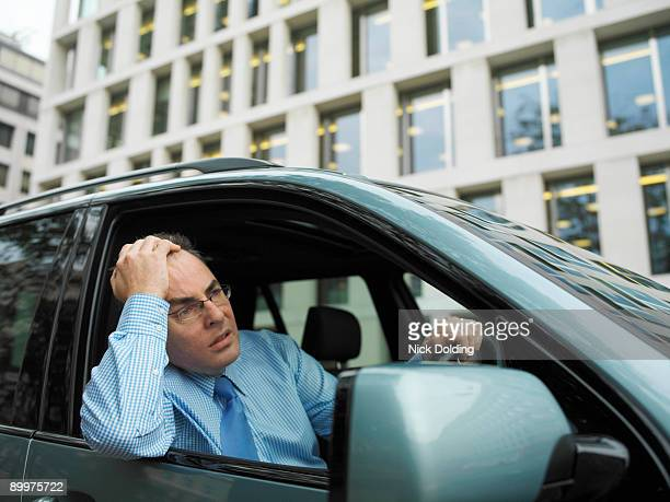 Frustrated businessman in car