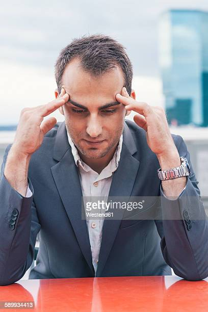 Frustrated businessman looking down