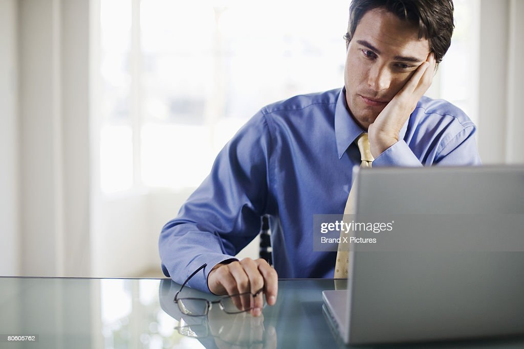 Frustrated businessman with laptop computer : Stock Photo