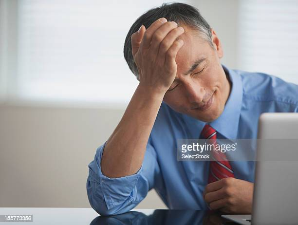 Frustrated businessman with laptop