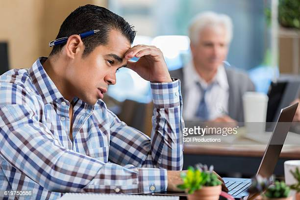 Frustrated businessman works on project