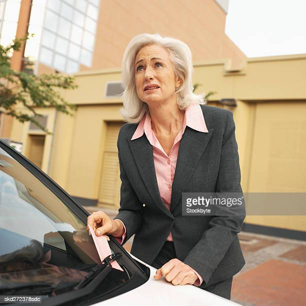 Frustrated businesswoman after getting parking ticket