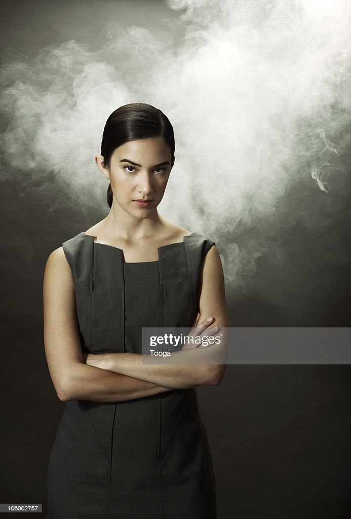 Frustrated businesswoman fuming with smoke : Stock Photo