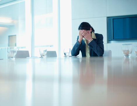 Frustrated businesswoman sitting at conference table - gettyimageskorea