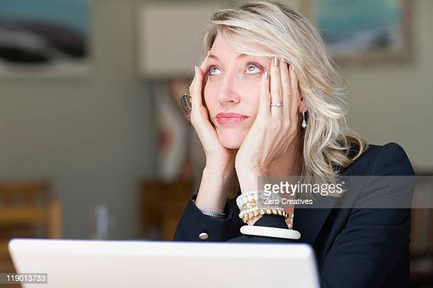 Frustrated businesswoman using laptop