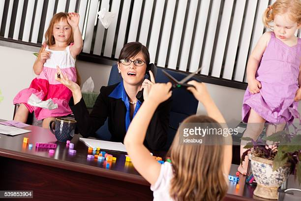 Frustrated Businesswoman with Children in Office