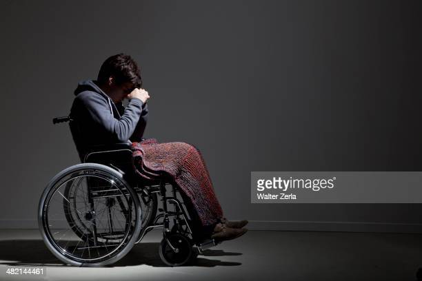 frustrated caucasian man in wheelchair - paraplegic stock photos and pictures