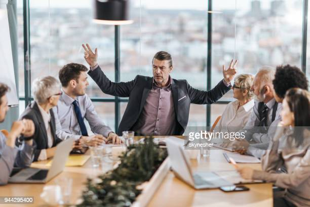 frustrated ceo is angry at his colleagues during a meeting in the office. - anger stock pictures, royalty-free photos & images
