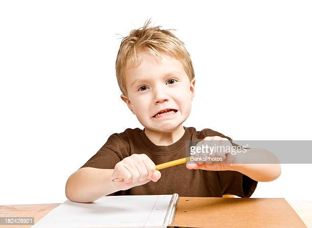 Frustrated Child Boy Student Attempts to Break a Pencil