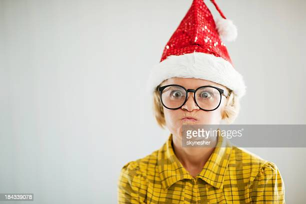 frustrated funny looking woman wearing christmas hat. - santa face stockfoto's en -beelden
