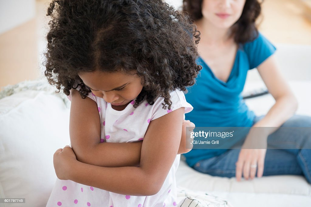 Frustrated girl ignoring mother : Stock Photo