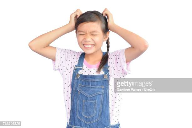 Frustrated Girl Standing Against White Background
