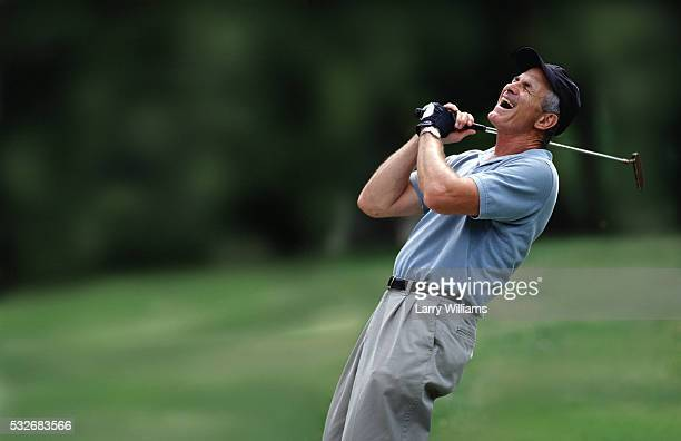 frustrated man holding golf club - golfer stock pictures, royalty-free photos & images