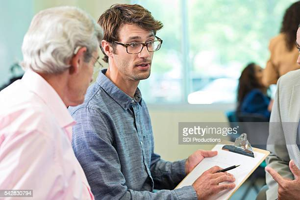 Frustrated man leading meeting
