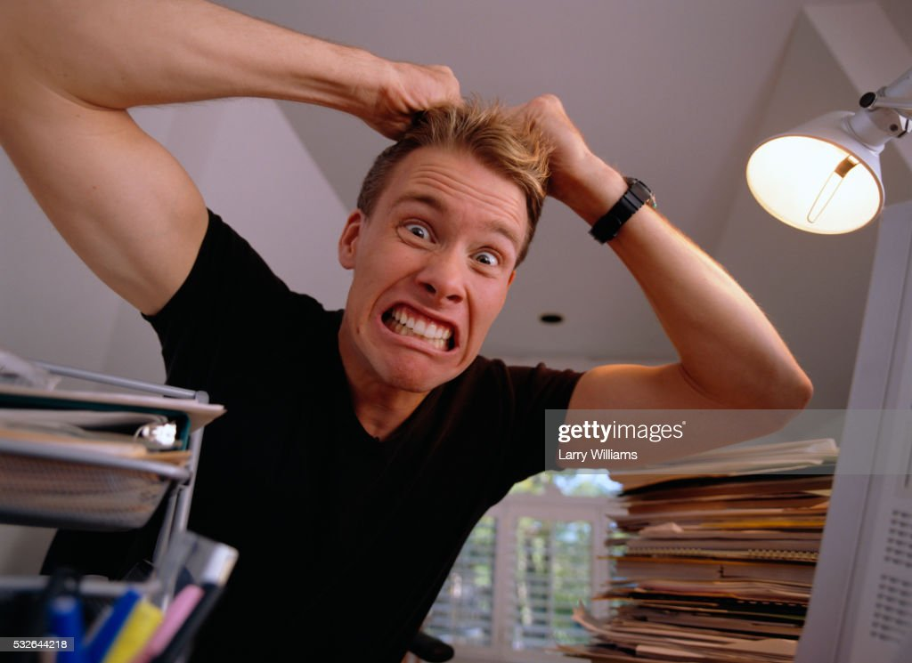 Frustrated Man Pulling Hair in Home Office : Stock Photo