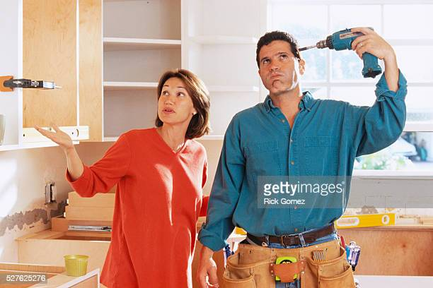 Frustrated Man Renovating Kitchen with Wife