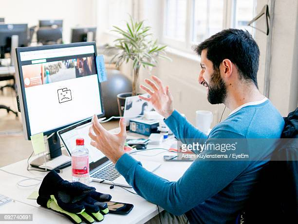 Frustrated Man Working In Office