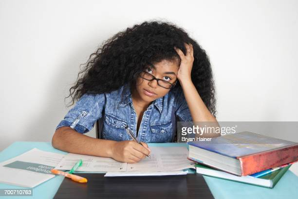Frustrated Mixed Race teenage girl doing homework