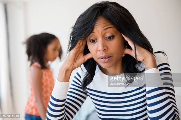 frustrated mother rubbing her temples - irritation stock pictures, royalty-free photos & images