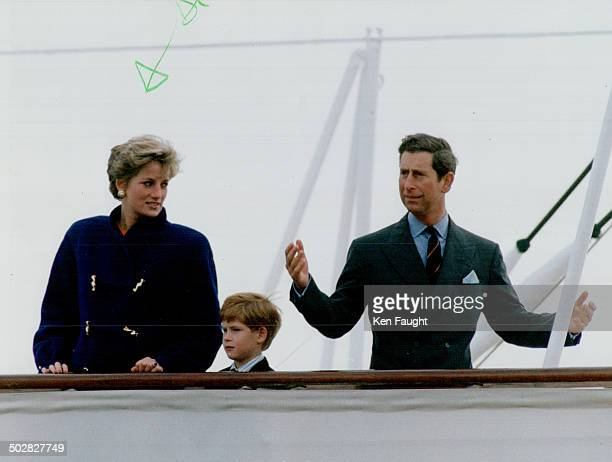 A frustrated Prince Charles awaits his elder son William on Britannia's top deck yesterday The boy was scolded for spending too much time elsewhere...