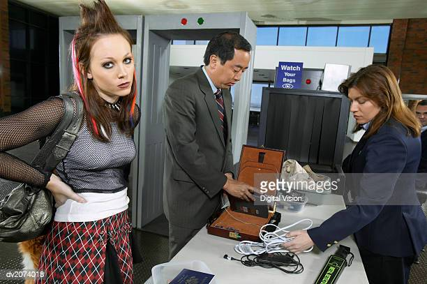frustrated punk woman waiting at airport security - metal detector security stock pictures, royalty-free photos & images