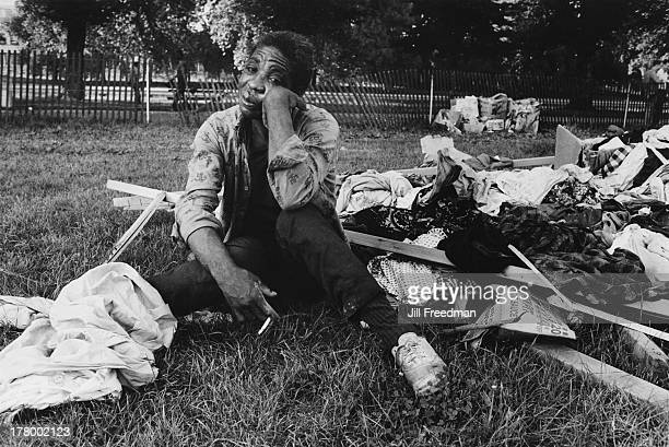 A frustrated resident sits with donated clothing after it is left out in the rain at Resurrection City a three thousand person tent city on the...