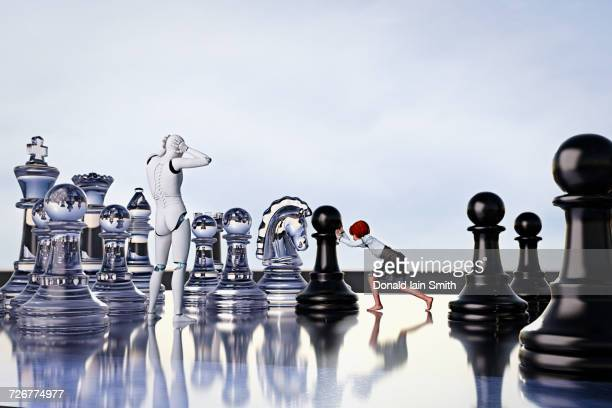 Frustrated robot watching girl playing chess with large pieces
