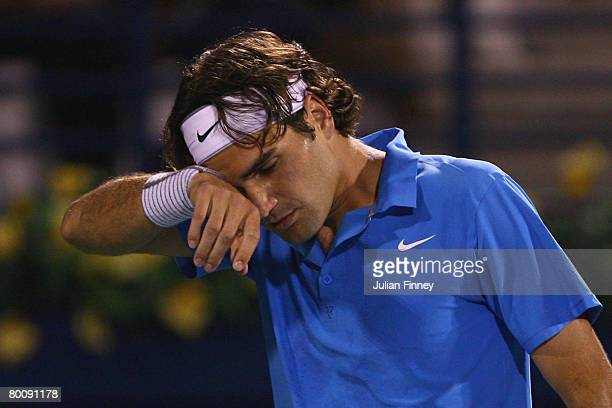 A frustrated Roger Federer of Switzerland in his match against Andy Murray of Great Britain pose for photos before their match during the ATP...
