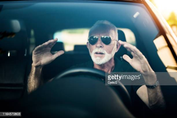 frustrated senior man in traffic. - white hair stock pictures, royalty-free photos & images