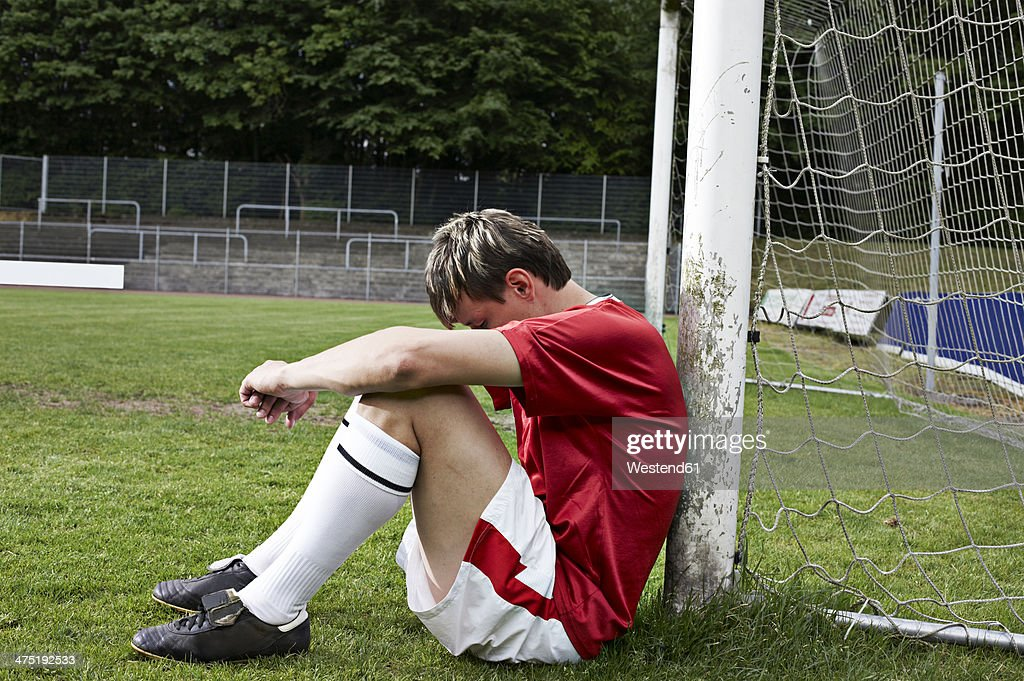 Frustrated soccer player on field : Stock Photo